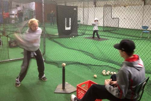 Pirate sophomore Hunter Bradshaw works with Journey Perdue hitting off the tee