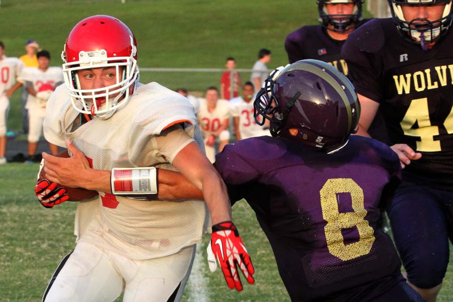 Poteau's Austin Skelton tries to break away from Heavener's Trey Grubbs in Friday's scrimmage