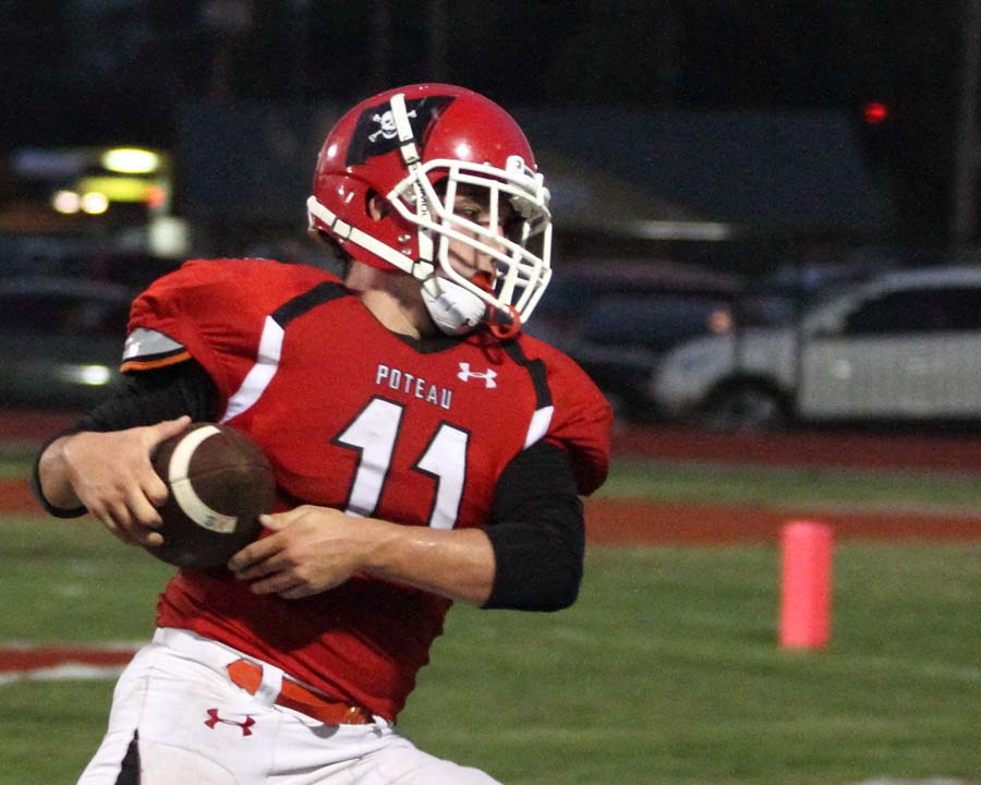Poteau's Kade McMillin hauls in a touchdown pass in last week's win over Campus