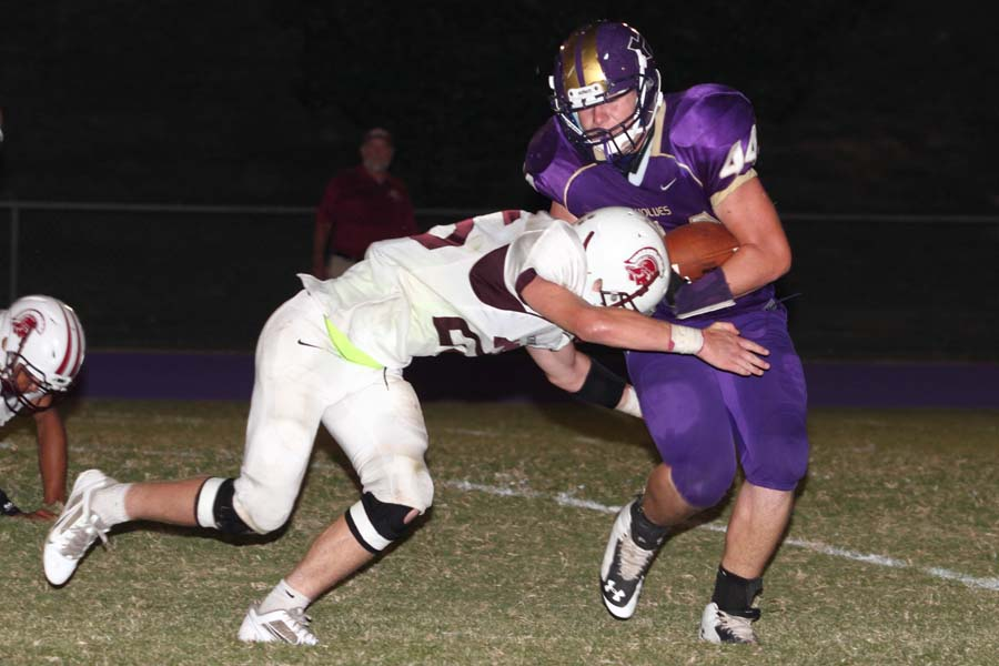 Heavener's Luke McGee tries to break away from the tackle of Eufaula's Hunter Reynolds