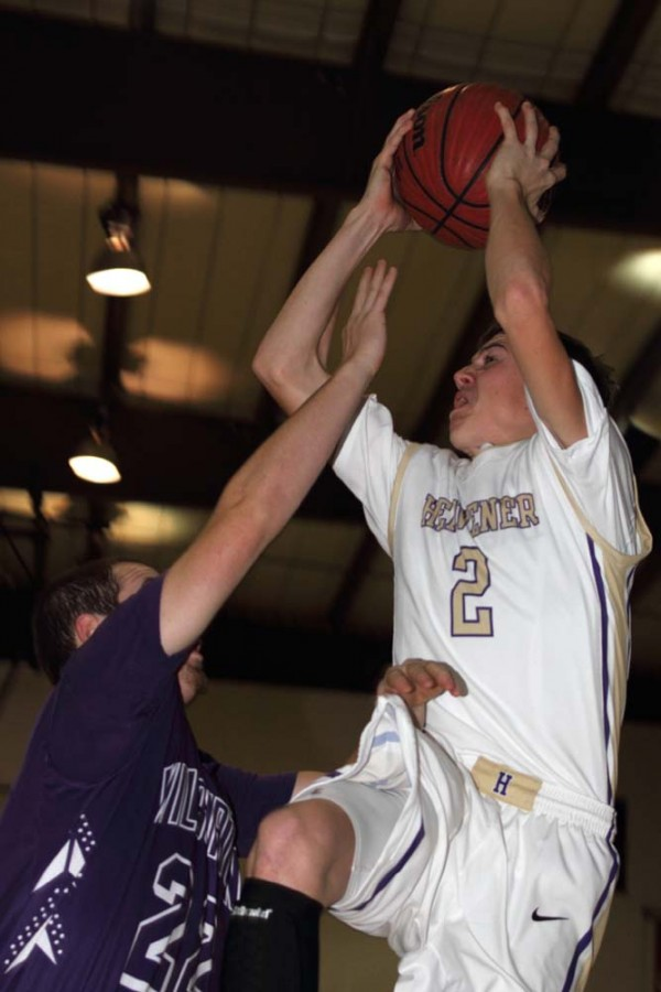 Chance Dunigan of Heavener gets the shot off against Wilburton's Kendall McAlester
