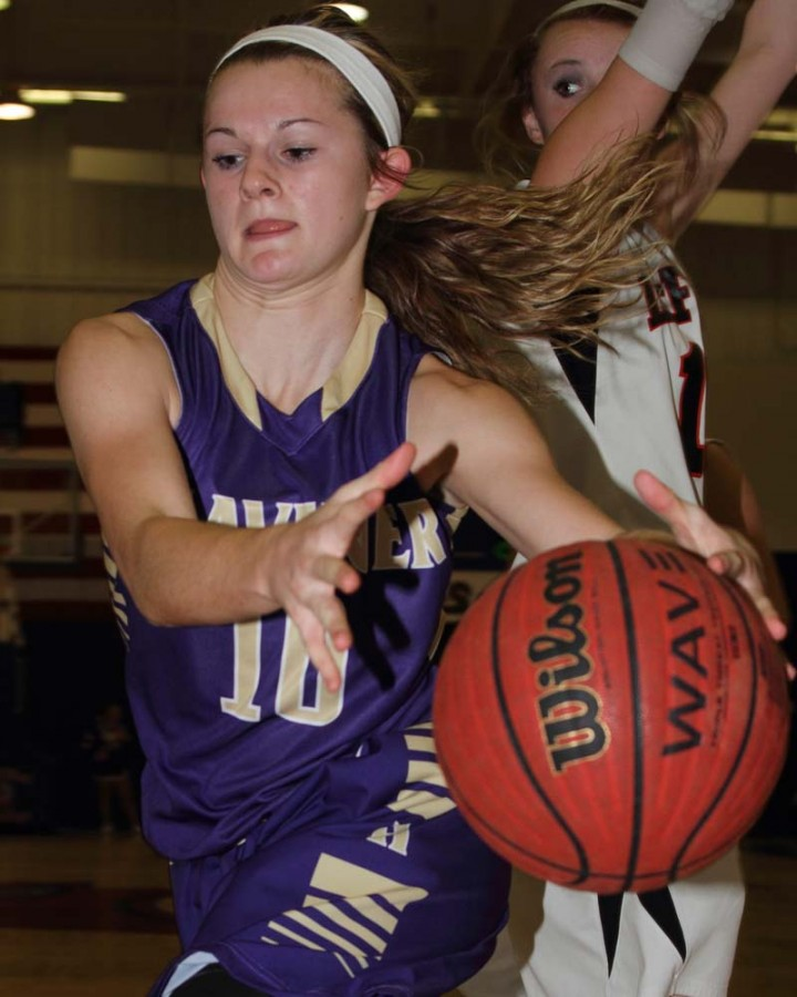 Heavener's Jodie Hill tries to hang on to the ball as she drives against LeFlore