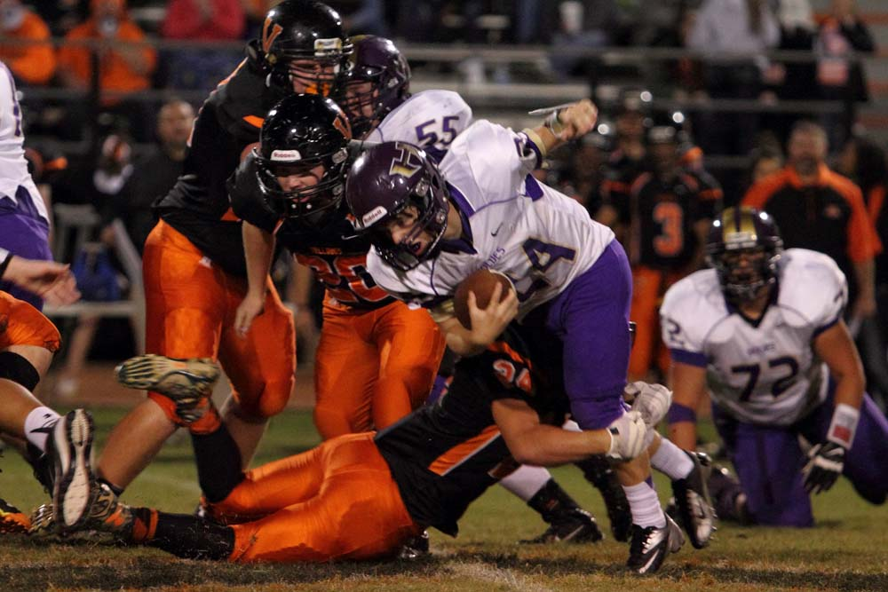 Heavener's Connor Place tries to get away from a Valliant defender in last week's game