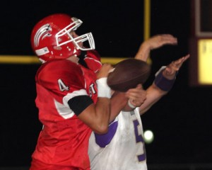 The Wolves' Dillan Stallings breaks up a pass intended for Stigler's Dawson Barger