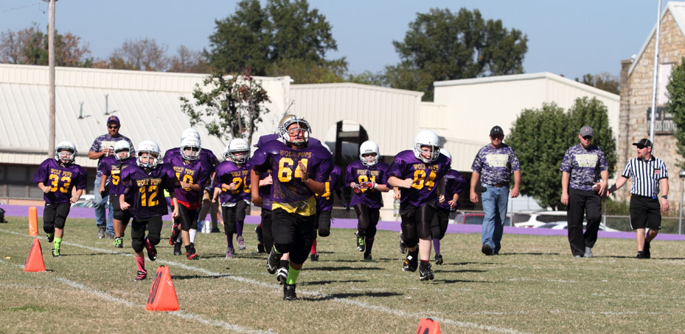 The third and fourth grade Heavener Wolf Pups take the field prior to the game against Waldron.