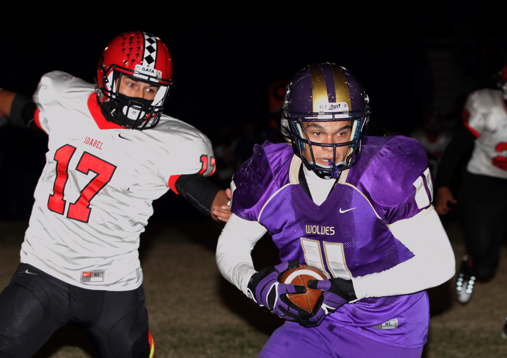 Bryce Tolleson grabs a pass for a good gain in front of Idabel's Juan Fabian