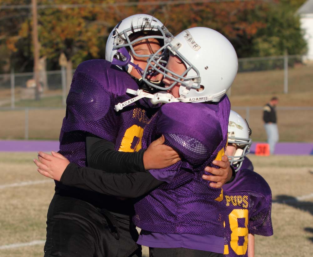 A pair of Heavener players celebrate after the game ends.