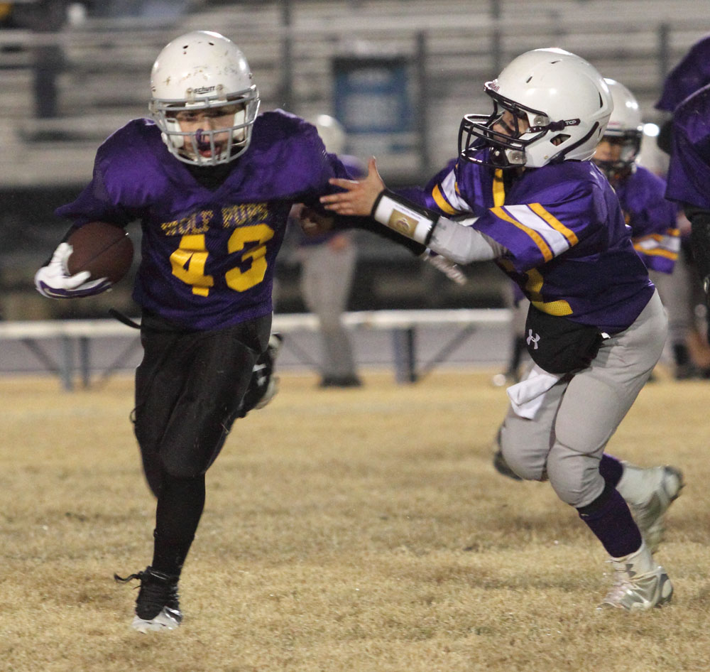 Heavener's C.J. Halford fights to get away from a Booneville defender