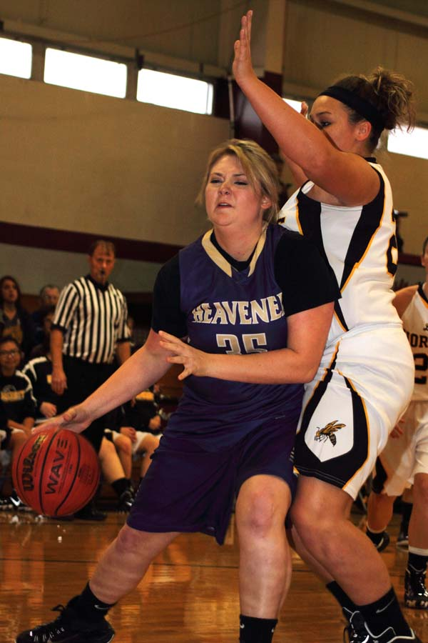 Heavener's Sydney Crase drives for a basket in the first half against Hackett