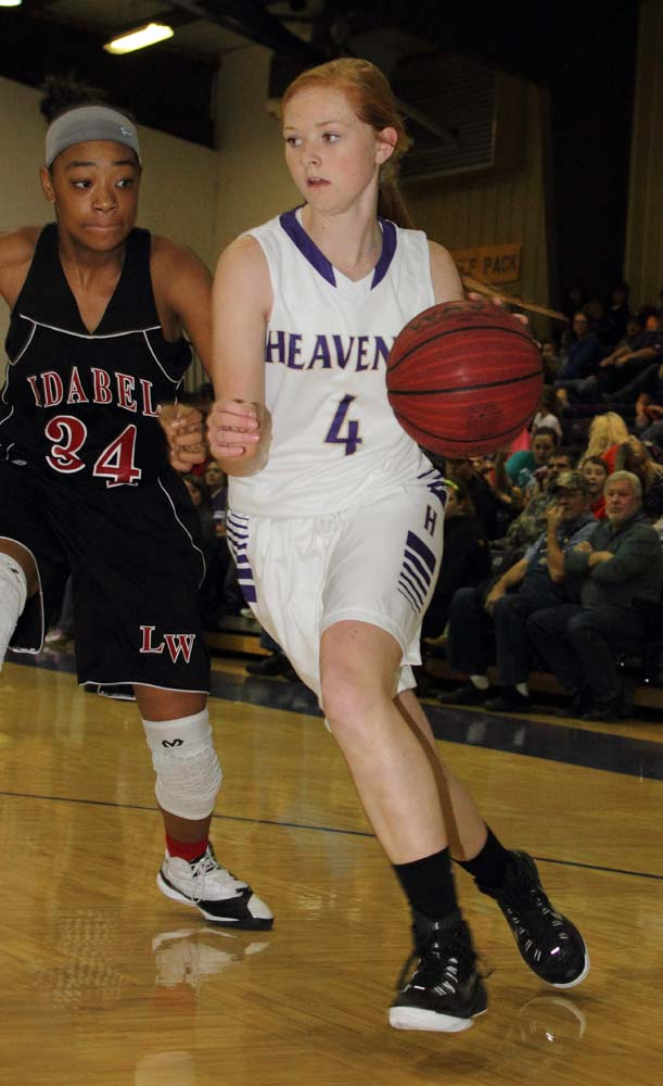 Heavener's Emily Yandell drives past Idabel's Shyla Smith