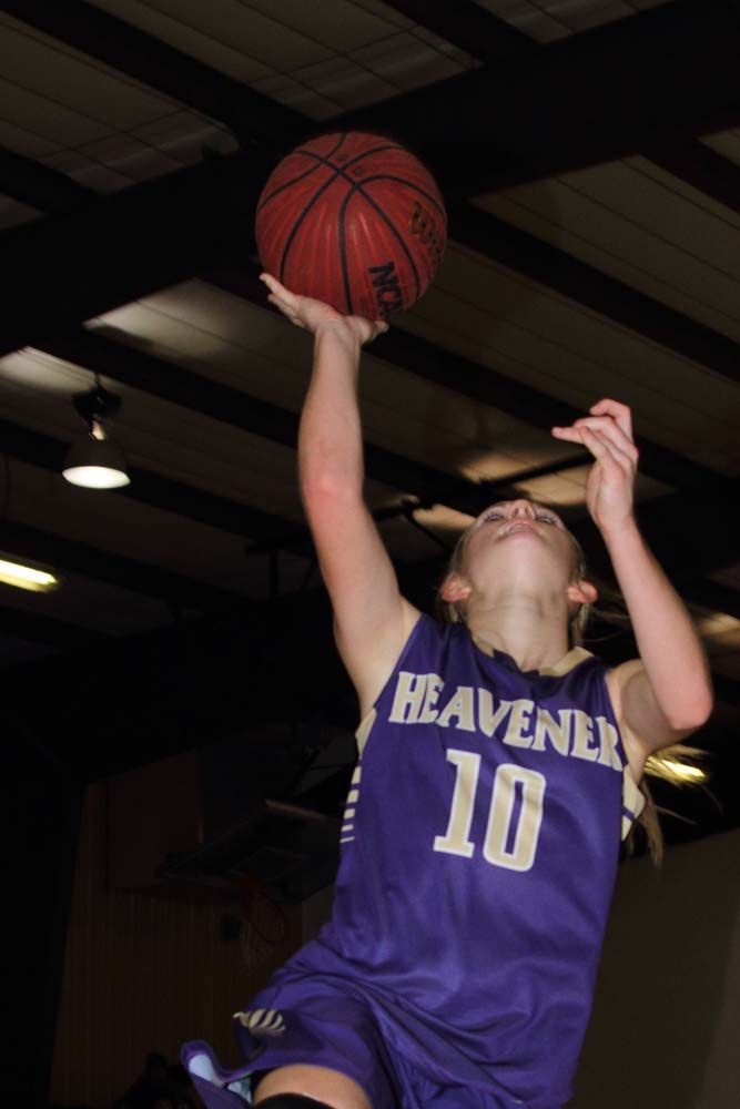 The Lady Wolves' Jodie Hill goes in for a layup in last week's game against Acorn.