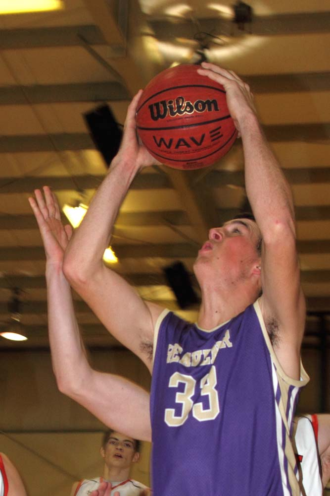 Heavener's Colt Dunigan goes up for a basket in the loss at Poteau.