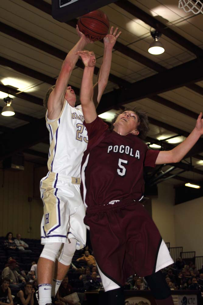 Dillion May goes up for a shot for Heavener as Pocola's Drew Minks defends