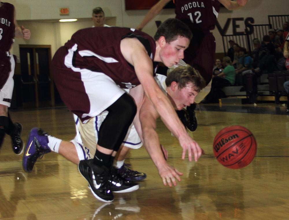 Heavener's Connor Place, right, and Pocola's Brandon Thompson go after a loose ball in Tuesday's game