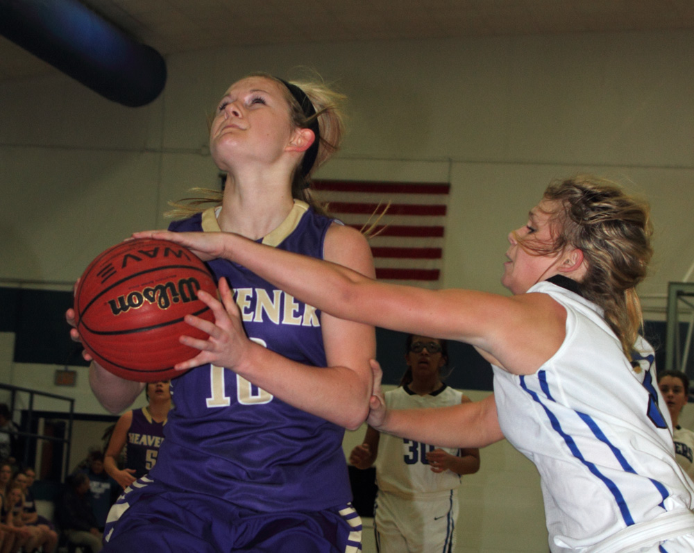 Heavener's Jodie Hill tries to get a shot off with a Hartshorne defender going for the block