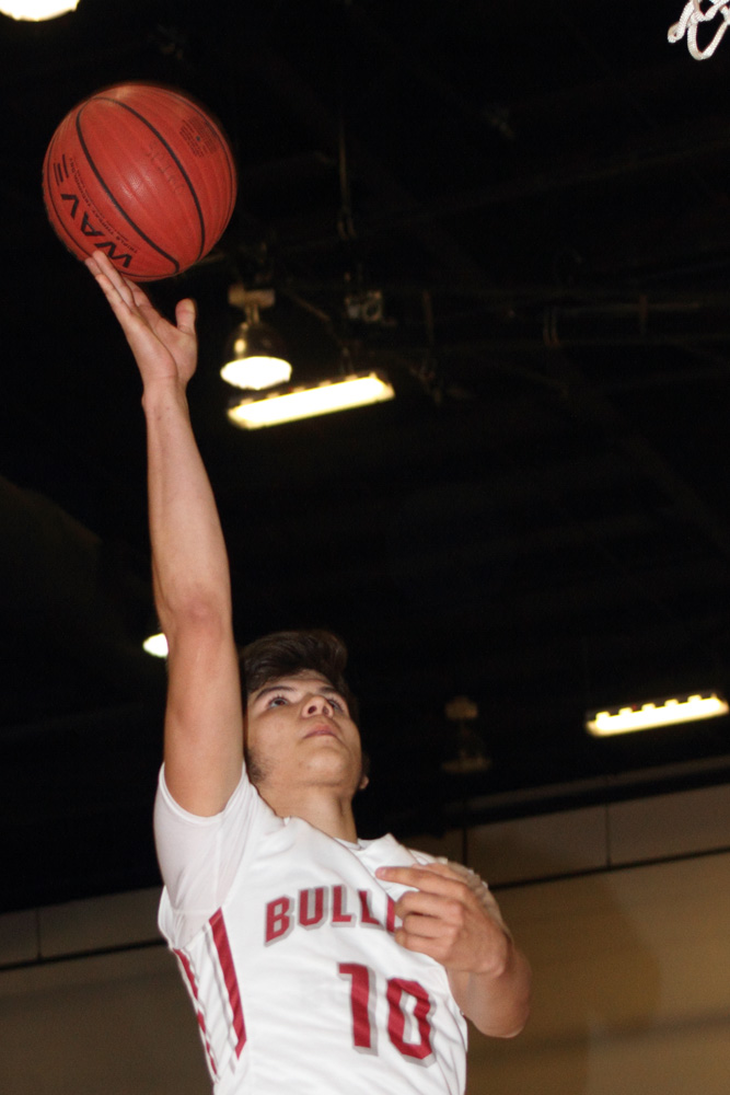 Jerry Vega, shown here in the win over Hartshorne on Thursday, and Spiro will have to wait until Tuesday to play Sequoyah Tahlequah in the 3A regional tournament. Vega scored 23 points in the win over the Miners