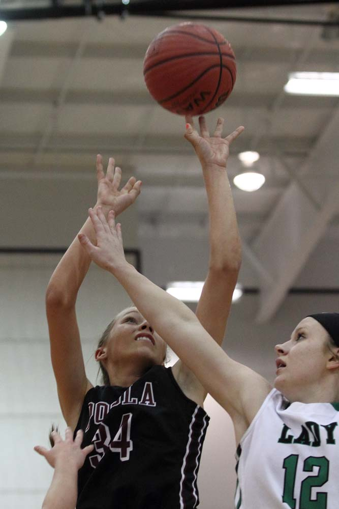 Pocola's Brooklyn Morton gets a shot off against Quinton's Taylor Myers