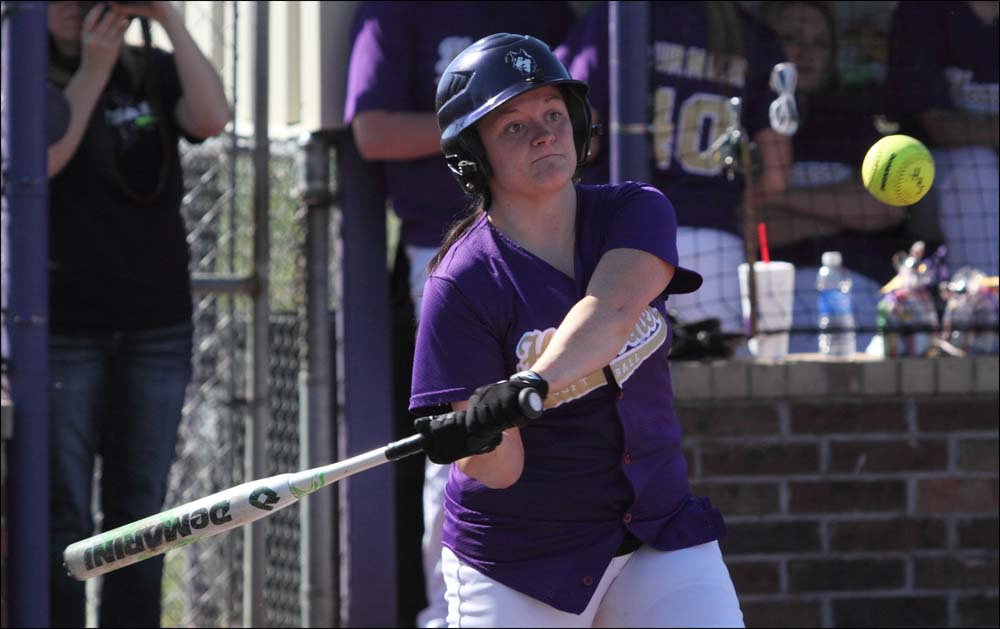 Kendra Davis slams a hit in a game earlier against Howe. Davis and the Lady Wolves got the top seed for next week's LCT