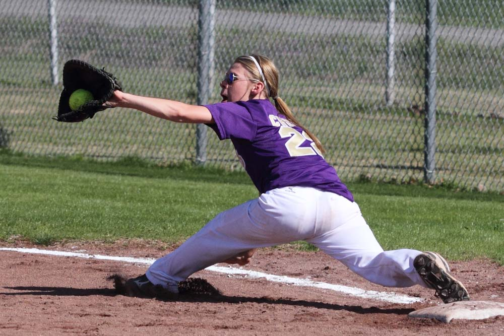 Makayla Cheek stretches out to get the throw to complete a double play in the win over Hartshorne