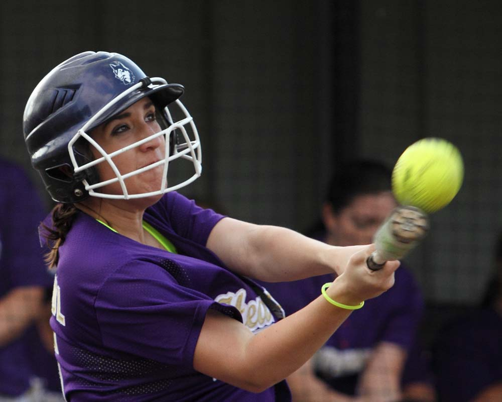 Heavener's Lily Friedl gets hold of a pitch in the 9-0 win over Oktaha on Thursday