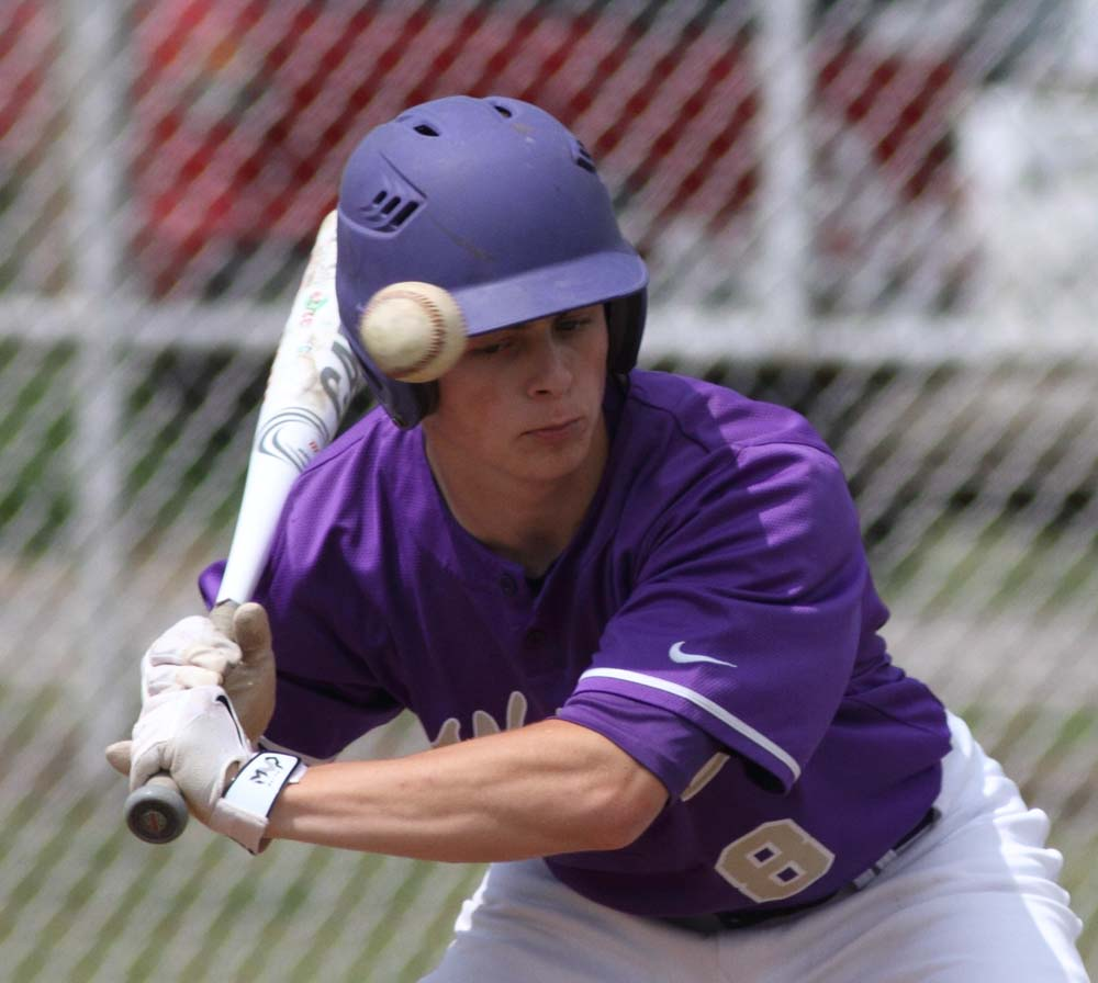 Heavener's Trey Grubbs gets a close look at a pitch in the game against Spiro