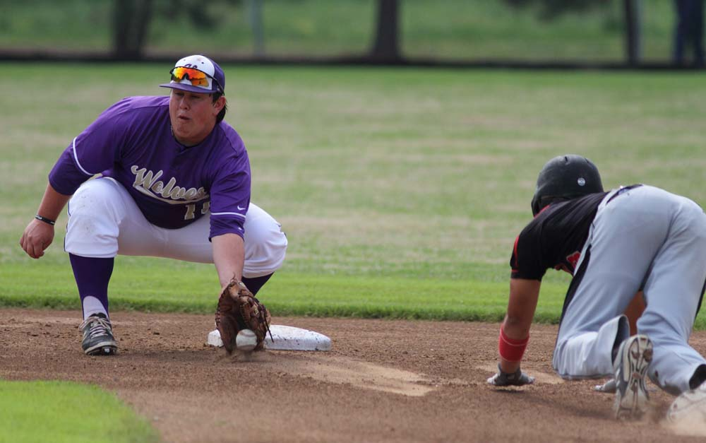 Heavener shortstop Grant Shipman gets ready to tag out Panama's Tristan Thompson on a steal attempt