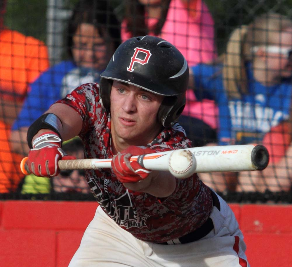 Poteau's Hunter Bradshaw lays down a bunt in the win over Wister