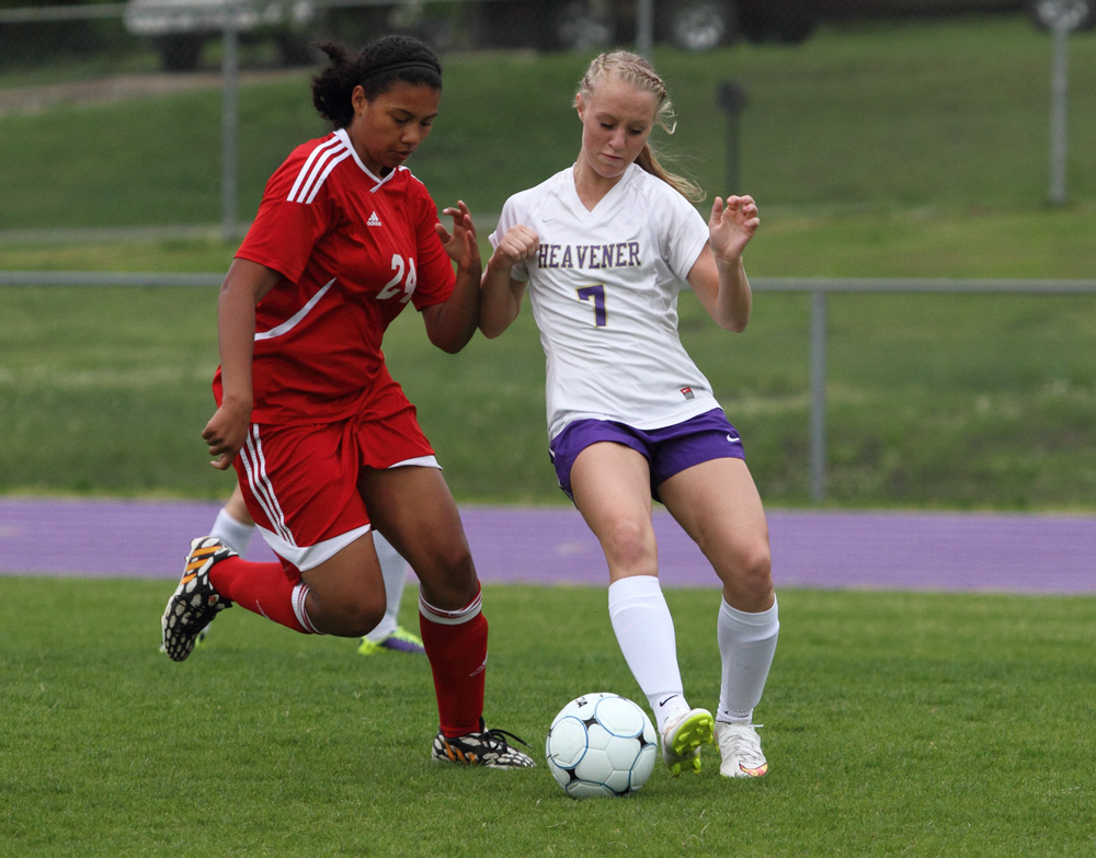 Heavener's Kacee Manley, right, battles with Poteau's Kaitlyn Henderson for control of the ball