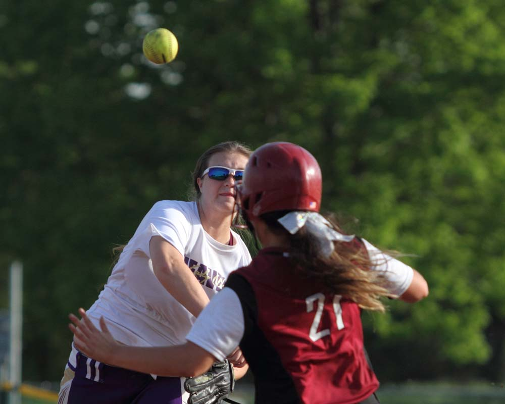 Heavener's Lakota Vickers makes the throw at second base to try and complete the double play as Spiro's LuLu Robbins begins to slide