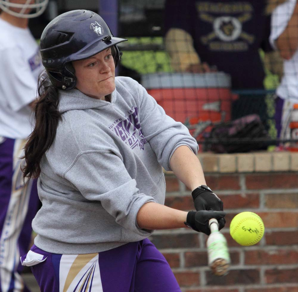 Kendra Davis bangs out a hit for Heavener in the 13-2 win over Poteau