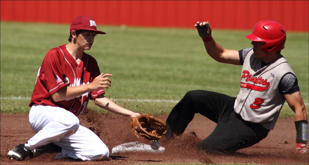 Poteau's Roger Barcheers slides into second base as Muldrow's Caleb Armer has trouble fielding the throw