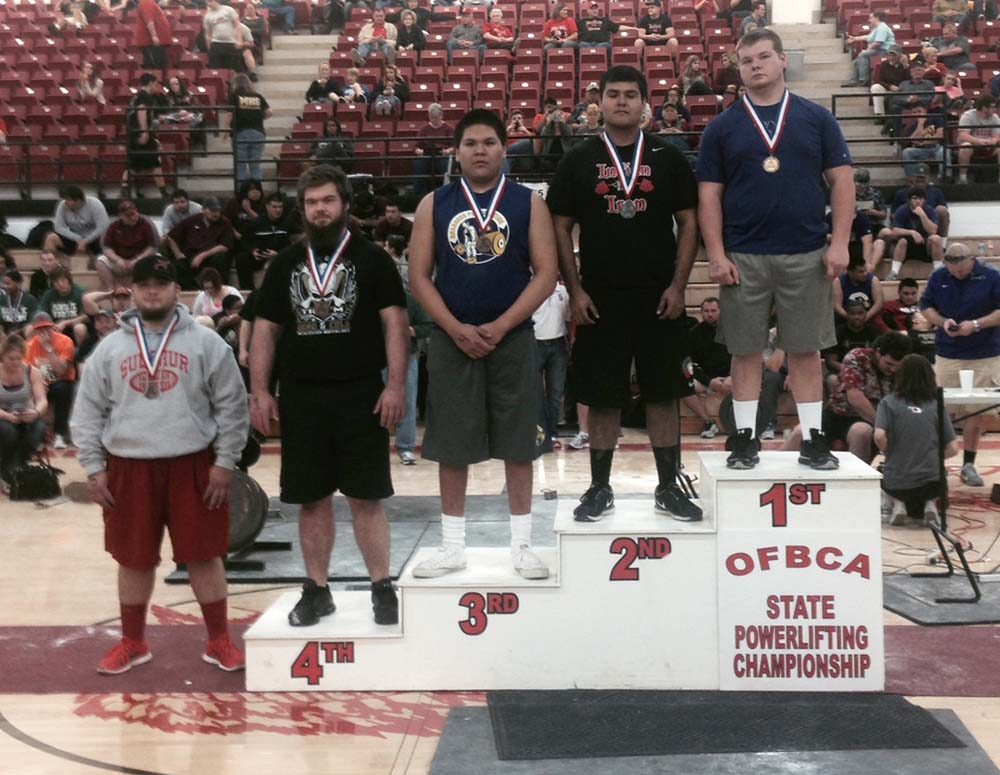 Heavener's Justin Page, far right, won the 242-pound class at the state powerlifting meet on Friday