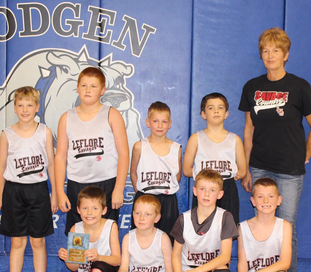 LeFlore Elementary third and fourth grade boys display a plaque after placing third in Hodgen Tournament. Players are: front row: Mason Green, Cheslor Brown, Luke  Herell, Rylan Luman. Back row: Joshua Waddles, Brex Caldwell, Isaiah Lloyd, Thomas White and Coach Bobbie Waits.