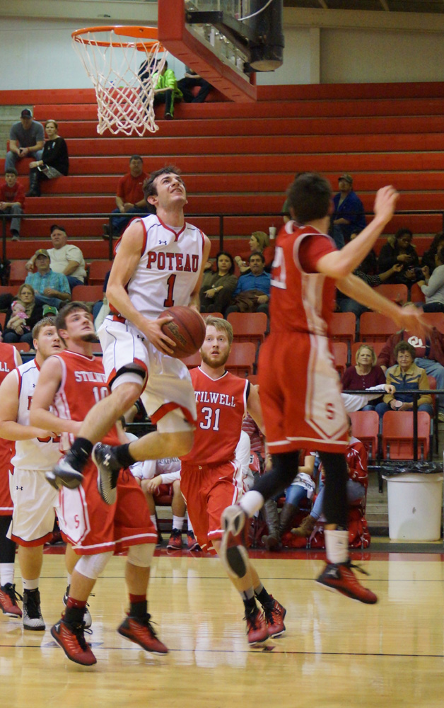 Photo by RAMONA SMITH--Poteau's Kanaan Hardaway battles for a shot in Tuesday's game with Stilwell