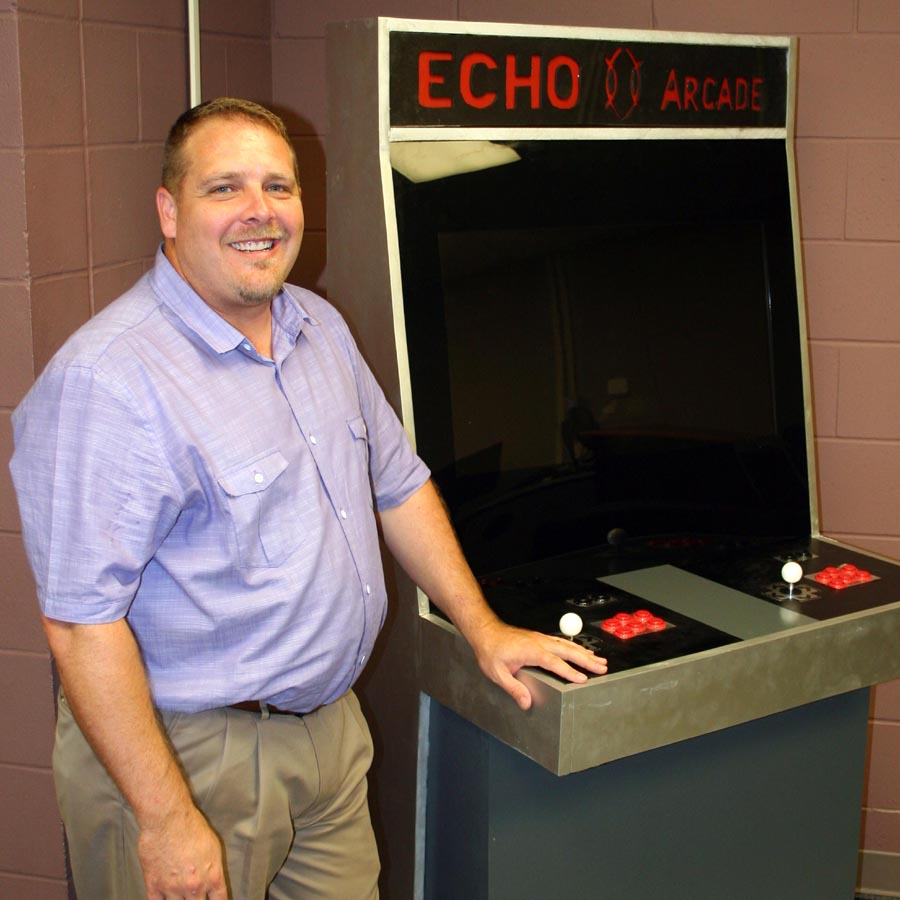 CASC computer science teacher Tommy Smith shows off the game his students built