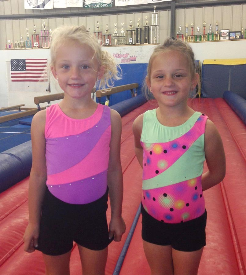 Avery Lewis is the gymnastics star and Gracie Lewis is the shooting star