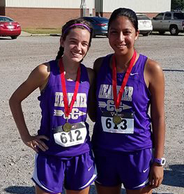 Heavener cross country runners Barbara Johnson, left, was first, and Iris Martinez, right, came in 10th at Mansfield on Saturday